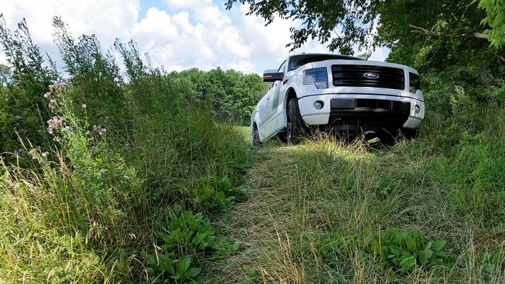 Large wheels and a high ride on the 2014 Ford F-150 Tremor review vehicle make it possible to climb steep hills like this to access good fishing and other off road areas.